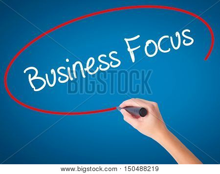 Women Hand Writing Business Focus With Black Marker On Visual Screen.