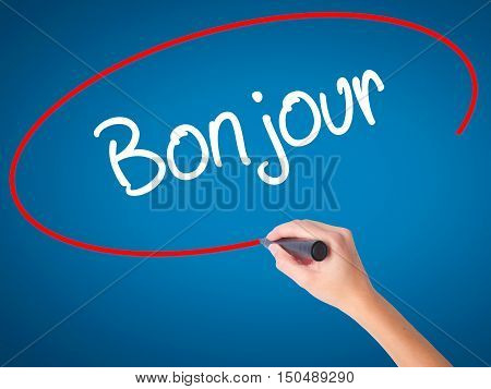 Women Hand Writing Bonjour  (good Morning In French) With Black Marker On Visual Screen
