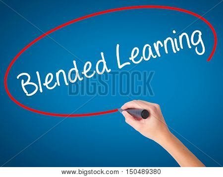 Women Hand Writing Blended Learning   With Black Marker On Visual Screen