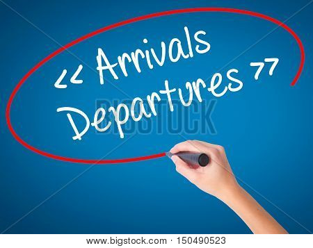 Women Hand Writing Arrivals - Departures With Black Marker On Visual Screen.