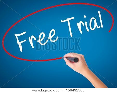 Women Hand Writing Free Trial With Black Marker On Visual Screen