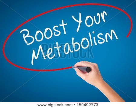 Women Hand Writing Boost Your Metabolism With Black Marker On Visual Screen