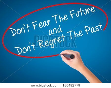Women Hand Writing Don't Fear The Future And Don't Regret The Past With Black Marker On Visual Scree