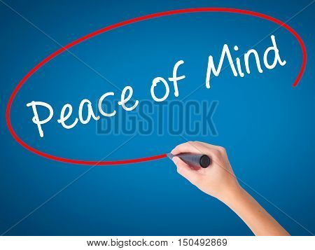 Women Hand Writing Peace Of Mind Black Marker On Visual Screen