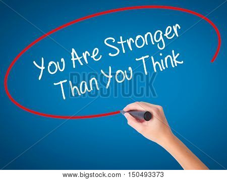 Women Hand Writing You Are Stronger Than You Think With Black Marker On Visual Screen