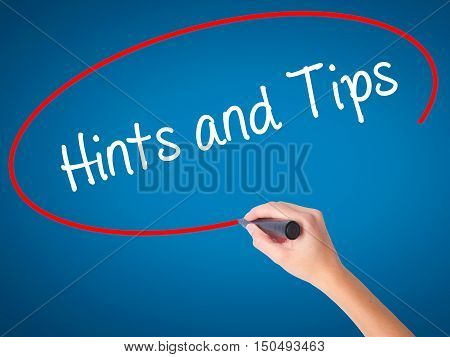 Women Hand Writing Hints And Tips With Black Marker On Visual Screen