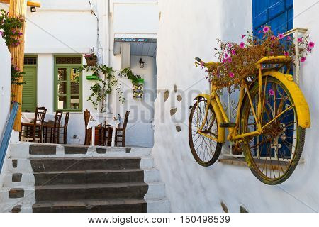 NAXOS, GREECE - SEPTEMBER 22, 2016: Taverna in the old town of Naxos on September 22, 2016.