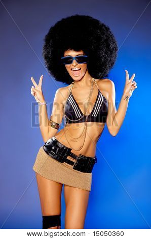 Beautiful woman with huge afro haircut color wall