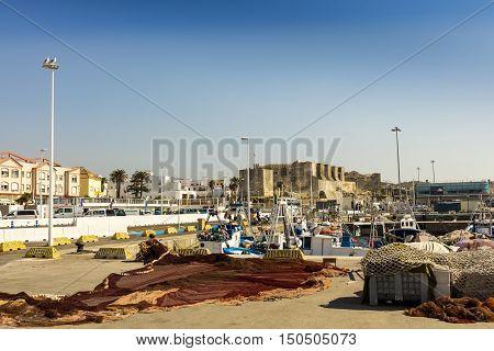 TARIFA, SPAIN - SEPTEMBER 23: Historic Port of Tarifa (Spanish: Puerto de Tarifa) is a commercial harbor for fishing and passenger boats on September 26, 2016.