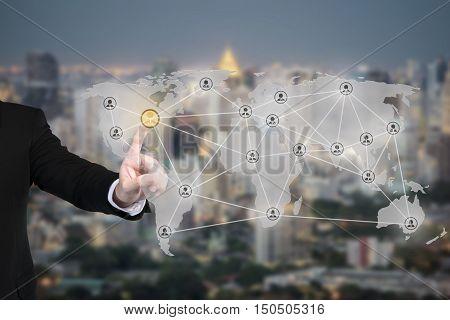 Businessman pressing modern social partnership network connectionbuttons on a virtual background. Partnership network connection
