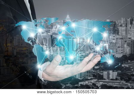 Global network connection map on hand of businessman for partnership network connection background (Elements of this image furnished by NASA)