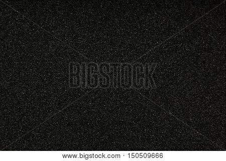 Black monotone grain texture. Glitter sand background.