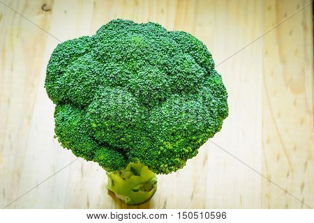 Broccolli on a wooden table. Healthy vegetables