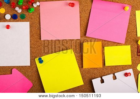 Blank Post It Notes And Pins On Pinboard Close-up