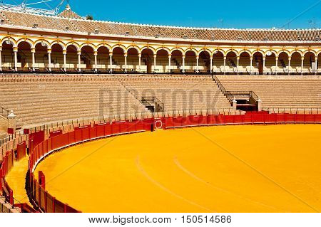 Arena of bullfighting in Seville at sunny day