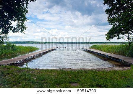 two wooden bridges over dominicke lake near boszkowo