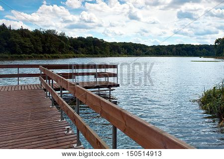 wooden bridge over lake at sunny day