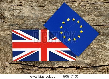 Brexit concept blue european union EU and Great Britain flags on wooden background. British vote to leave EU