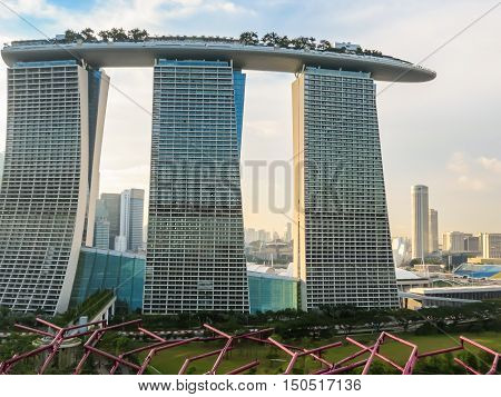 SINGAPORE, REPUBLIC OF SINGAPORE - JANUARY 09, 2014: Singapore city skyline. View of Marina Bay Sands Hotel from Supertree's rooftop. Supertree Grove, Gardens by the Bay, Singapore