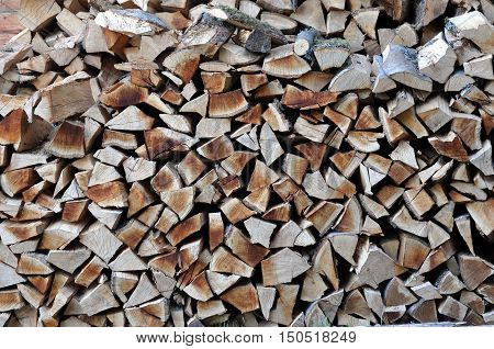Natural Wooden Background. Closeup Of Chopped Firewood