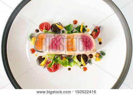fish steak with vegetables dinner in restaurant
