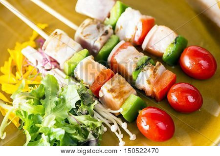 Skewers Fish Steak On Dish With Vegetables
