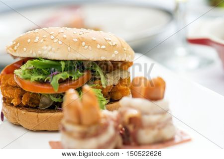 American cheese burger with fresh salad and hotdog