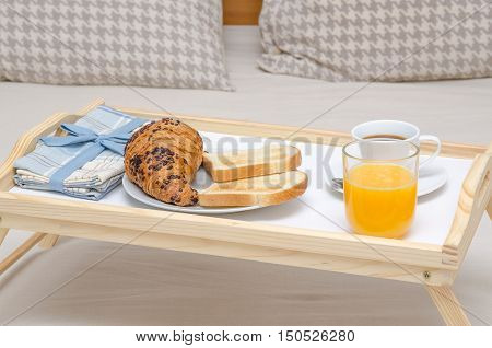 Breakfast on a tray on a bed