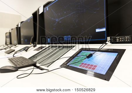 Sofia Bulgaria - September 12 2016: Bullgaria's Air Traffic Services Authority control center room. Controller's desk near control computer monitors. No people.