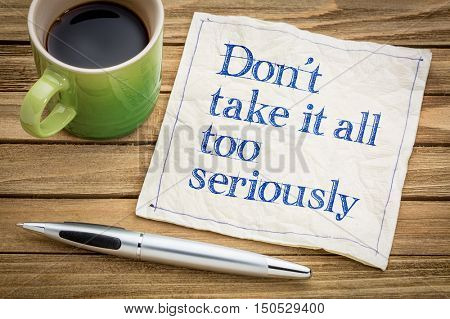 Do not take it all too seriously - handwriting on a napkin with a cup of espresso coffee