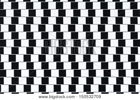 Lines are parallel but seem to be slanted - optical illusion.
