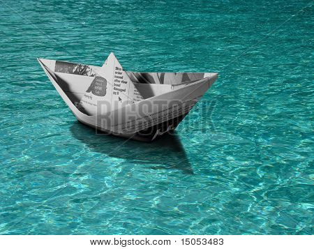 image of Paper boat floating on blue water poster