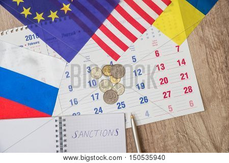 russia sanctions - flag, coins, sheet and pen