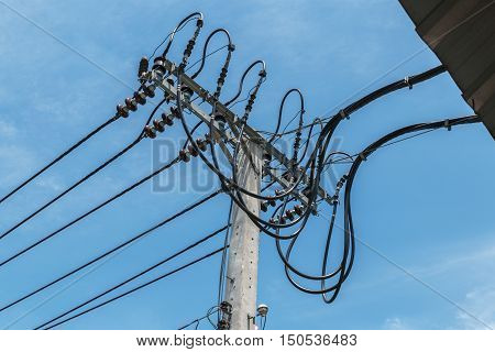 High-voltage wires on a light pole with  sky background