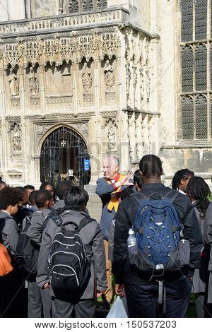 Canterbury United Kingdom - September 30 2016: Guide with school children outside Canterbury Cathedral