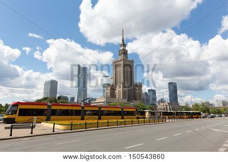 WARSAW POLAND - JUNE 11 2016: Architecture in downtown is seen together with the tram and buses standing at the stop one of the main streets of the city