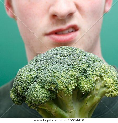 A man disliking broccoli