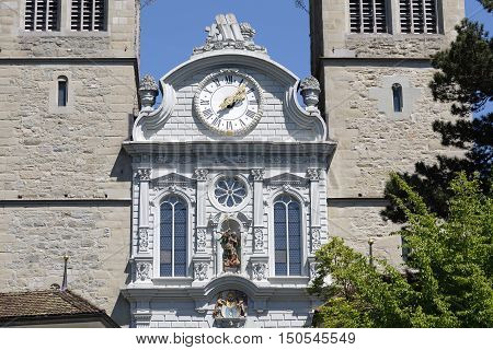 LUCERNE SWITZERLAND - MAY 06 2016: The clock is placed above the main entrance of Church of St. Leodegar that was built from 1633 to 1639. The towers made of stone can be seen on the both sides.
