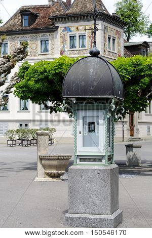 RAPPERSWIL SWITZERLAND - MAY 10 2016: Column that shows the geographic and weather data it is located on a pavement next to the small fountain