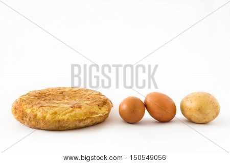 Traditional spanish omelette with potatoes and eggs isolated on white background