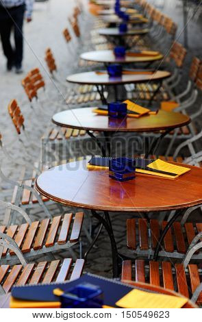 Tables and chairs of a restaurant on a sidewalk