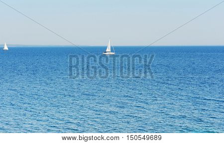 Skyline of the mediterranean sea with yachts