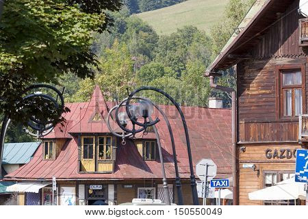 ZAKOPANE POLAND - SEPTEMBER 12 2016: Mountain style roof and diversity in the roof slants can be seen on the old wooden dwelling house that was built the early XX century