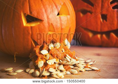 Pumpkin Puking With Pumpkin Seeds On Wood Table