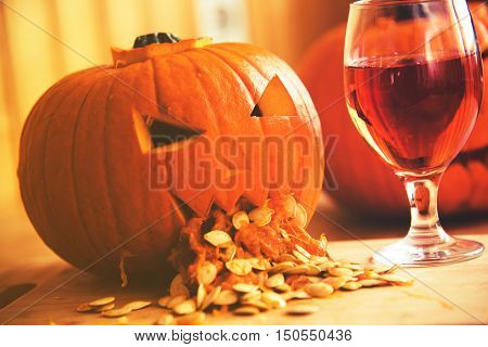Pumpkin Puking With Pumpkin Seeds On Wood Table, Glass Of Wine, Vintage Effect