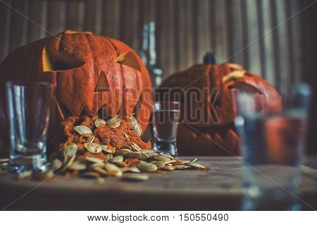 Pumpkin Puking With Pumpkin Seeds On Wood Table, Vodka, Hdr Effect