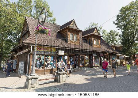 ZAKOPANE POLAND - SEPTEMBER 12 2016: Formerly residential building nowadays commercial building that is dated from approx in 1900 located by the Krupowki the main pedestrian street in the city
