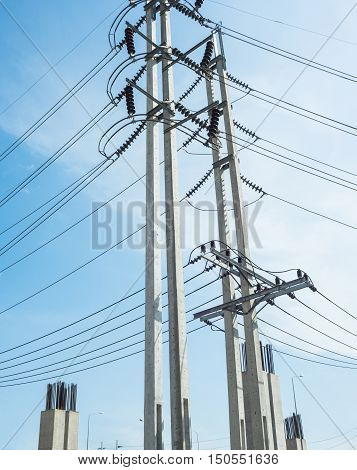 Two electricity post with blue sky background.