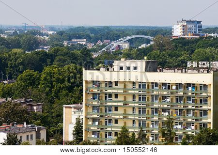 KOLOBRZEG POLAND - JUNE 25 2016: Sanatorium named Lech is housed in a tall building in a residential part of town and it is surrounded by green areas
