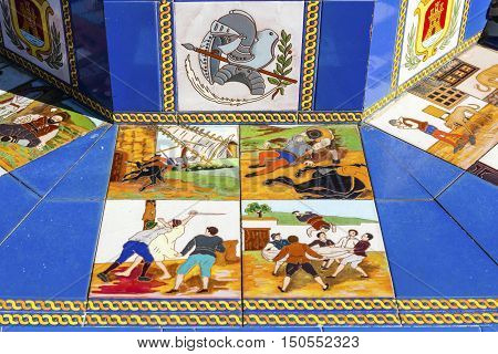 ALGECIRAS, SPAIN - SEPTEMBER 27: Closeup of brightly colored old ceramic decorations inspired by Cervantes' Don Quixote on public benches at the Plaza Alta in Algeciras, Spain on September 27, 2016.